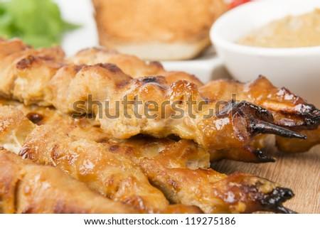 Moo Satay - Thai pork satay served with peanut sauce, cucumber relish ...