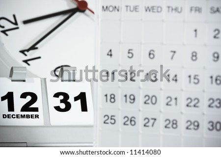 Mood shot of calendar with date and time background , focus on the flip date - intentional selective focus & vignetting. - stock photo