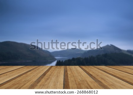 Moody landscape image of lake pre-dawn in Autumn with wooden planks floor - stock photo