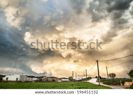 Moody rural landscape after storm. - stock photo