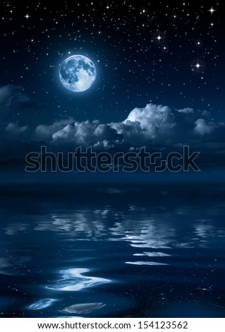 moon and clouds in the night on sea - stock photo