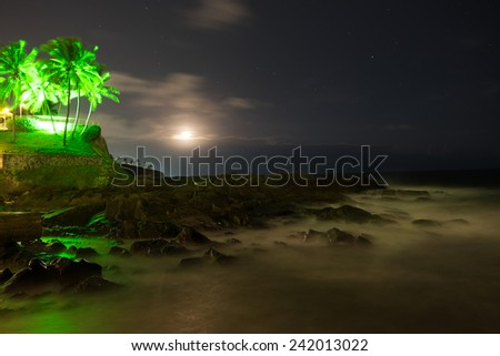 Moon at night with stars at the coast of Salvador de Bahia/Brazil. - stock photo