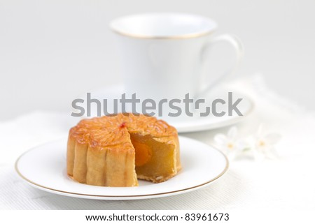 Moon cake served with tea, traditional dessert for the Chinese mid autumn festival