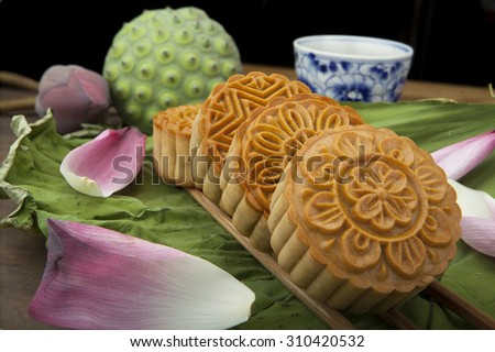 Moon cake traditional cake of Vietnamese - Chinese mid autumn festival food - stock photo