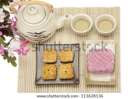 Moon cake two size with tea - stock photo