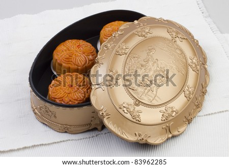 Moon cakes in beautiful box, traditional dessert for the Chinese mid autumn festival