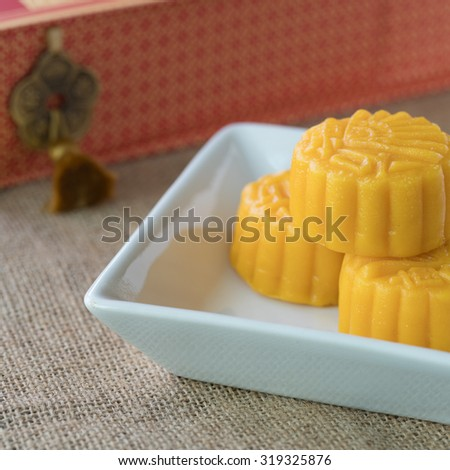 Moon cakes in white plate for the Chinese Mid-autumn festival - stock photo