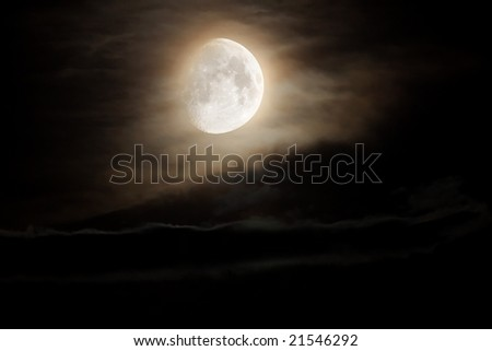 moon glowing in clouds