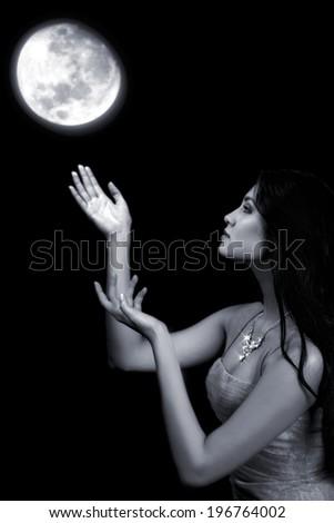 moon in hands. attractive fairy girl - stock photo
