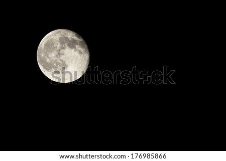 Moon in the black sky of the night