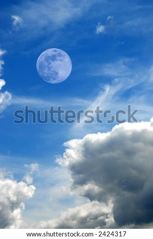 Moon in the clouds - stock photo