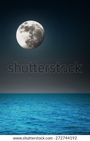 Moon in the night over the sea