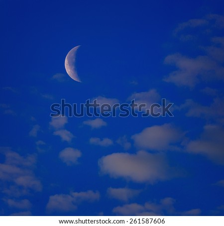 Moon in the sky with clouds. - stock photo