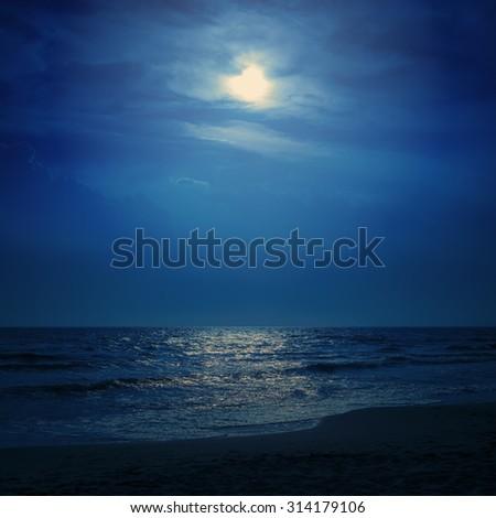 moon light in dark blue sky over sea - stock photo