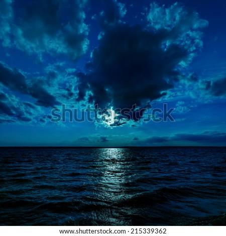 moon light over dark water - stock photo
