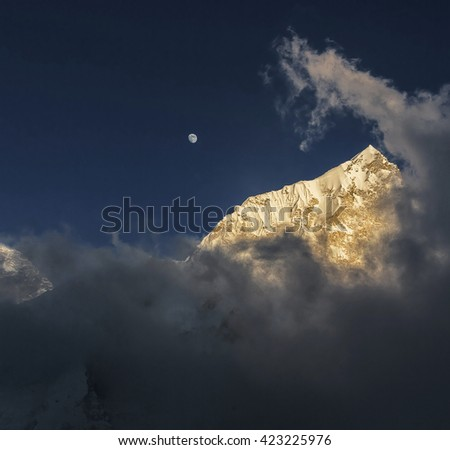 Moon Moon over Mt. Everest (8848 m) and Nuptse (7864 m) at sunset (view from Kala Patthar) - Everest region, Nepal - stock photo