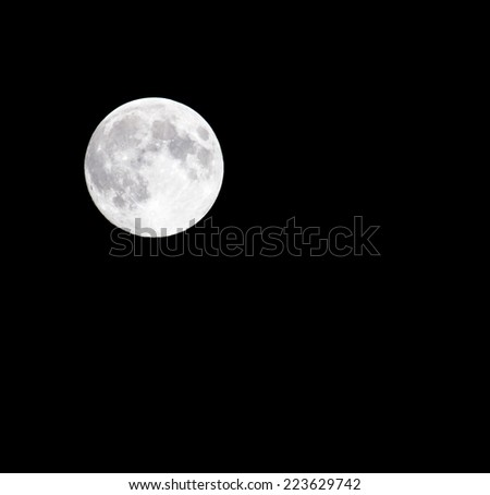 moon on a black background - stock photo