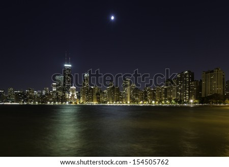 Moon over Chicago Downtown at night - stock photo