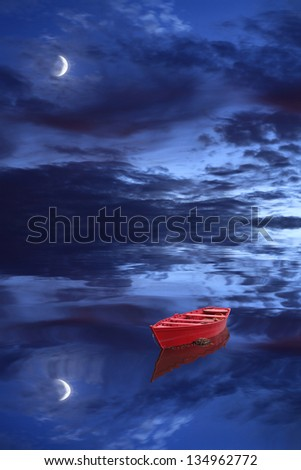 Moon, red boat and dark cloudy sky - stock photo