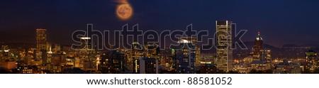 Moon Rise Over Portland Oregon City Skyline at Dusk Panorama - stock photo