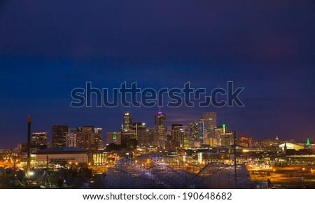 Moon Rising Over Denver Skyline - stock photo