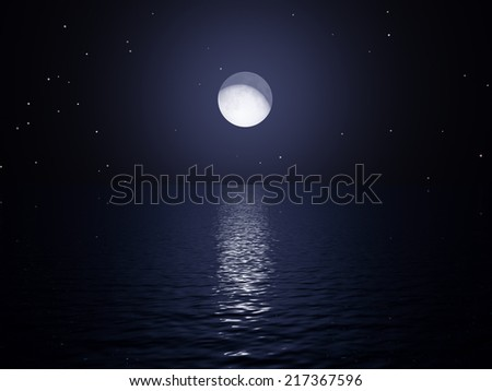 Moon rising over ocean with reflection on water - stock photo