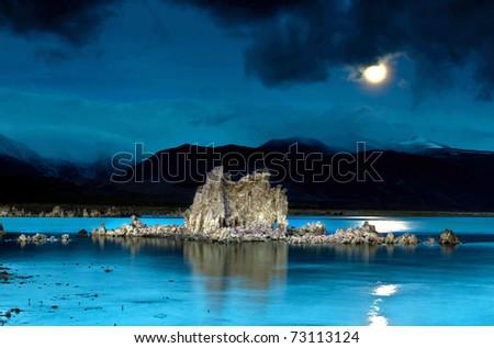 moon rising over tufas in mono lake California - stock photo