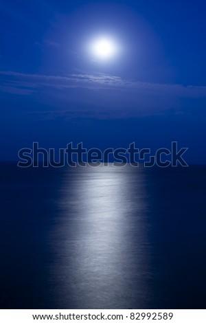 Moon's path to the sea - stock photo