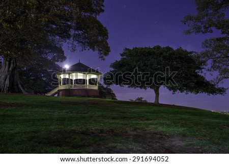Moon setting behind the pagola at Observatory Hill, Sydney NSW, Australia - stock photo