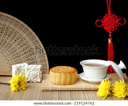 Mooncake and tea,Chinese mid autumn festival food. - stock photo