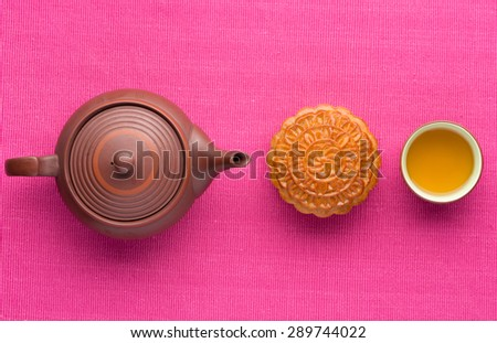 Mooncake and tea,food and drink for Chinese mid autumn festival. angle view from above - stock photo