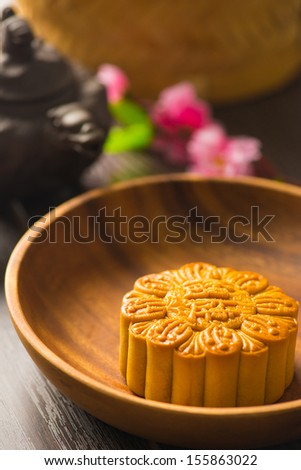 Mooncake for Chinese mid autumn festival foods. The Chinese words on the mooncakes means assorted fruits nuts, not a logo or trademark.  - stock photo