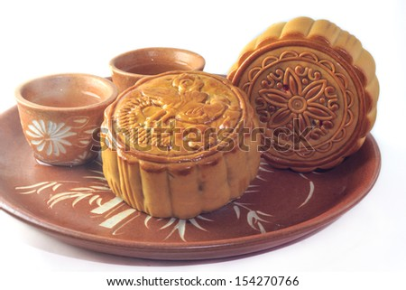 mooncake on a plate ready to be eaten - stock photo