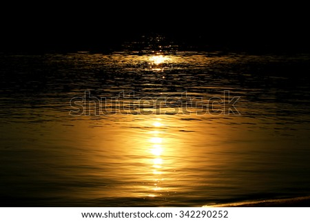 Moonlight on water night river - stock photo