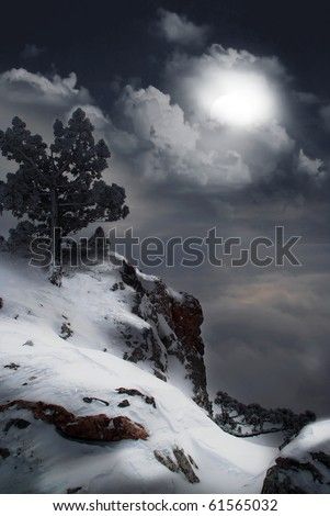 moonlit night and clouds on night sky in the mountains - stock photo