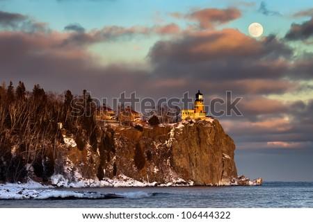 Moonrise and sunset at Split Rock Lighthouse, North Shore of Lake Superior, Minnesota (horizontal) - stock photo