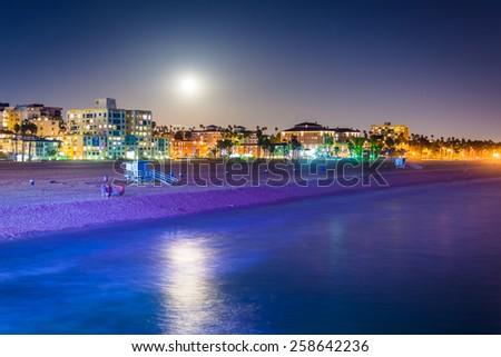 Moonrise over the beach in Santa Monica, California. - stock photo