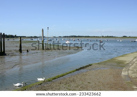 Moored boats at low tide in Chichester Harbour at Bosham. West Sussex. England - stock photo
