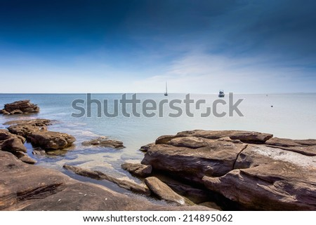 Moored boats in a bay on the north Western Australian coast. - stock photo