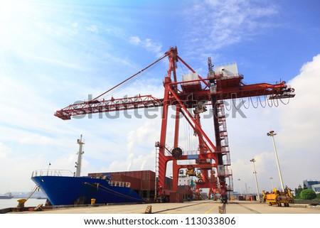 Moored container ship and gantry crane loading cargo in Mawei harbor,Fuzhou,China - stock photo