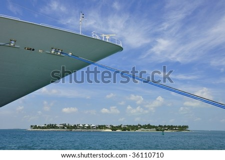 Moored Cruise Ship With Island In Background - stock photo