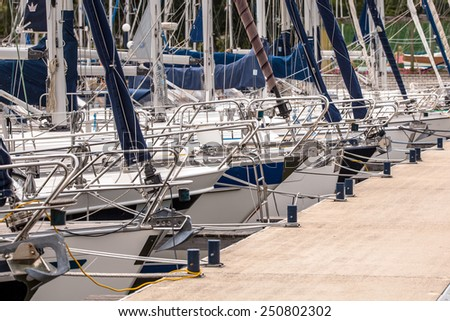 Moored Sailing Boats in a Marina in Friesland, Netherlands - stock photo