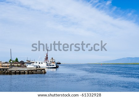 mooring and wharf with white boat at Baikal