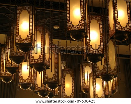Moorish lamps hanging from a wooden ceiling - stock photo