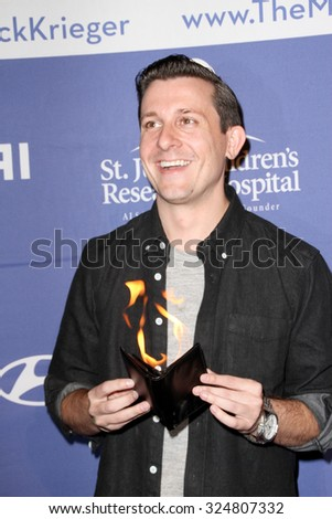 MOORPARK, CA - OCT 5: Magician Lee Terbosic arrives at the 8th Annual Medlock/Krieger Invitational Golf Concert at the Moorpark Country Club in Moorpark, CA on October 5, 2015. - stock photo