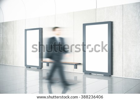 Mooving man and blank posters on the wall with wooden bench in empty hall, mock up, 3D Render - stock photo