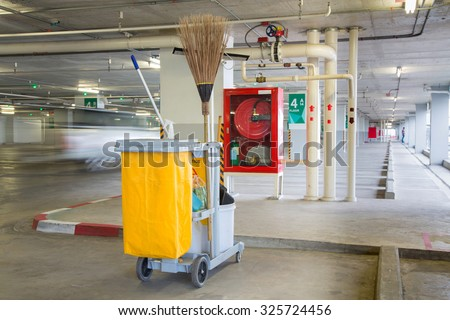 Mop bucket on cleaning in process - stock photo