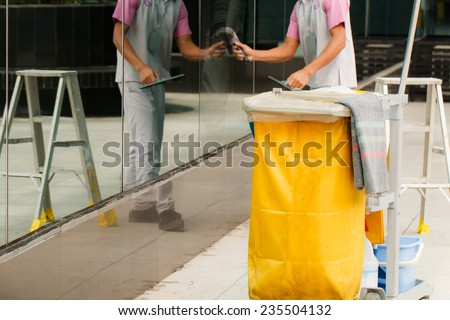 Mop bucket with cleaner background-2 - stock photo