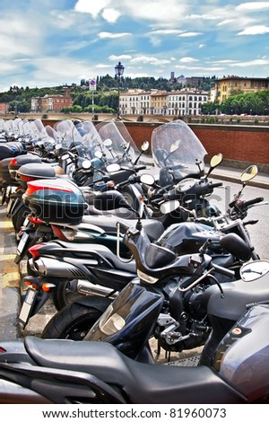 Mopeds parked in Florence Firenze Italy - stock photo