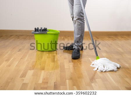 Mopping the Floor Closeup      - stock photo